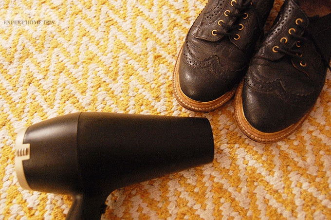 Loosen leather shoes with a hair dryer