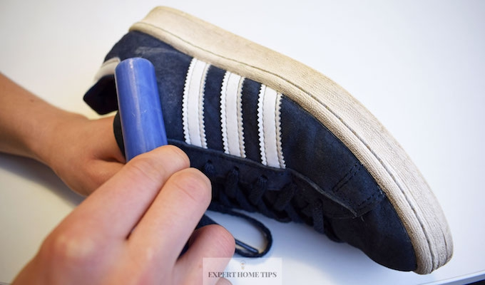 Using wax to water proof trainers