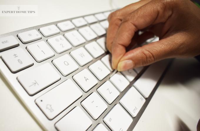 Use sellotape to clean inbetween keyboard keys