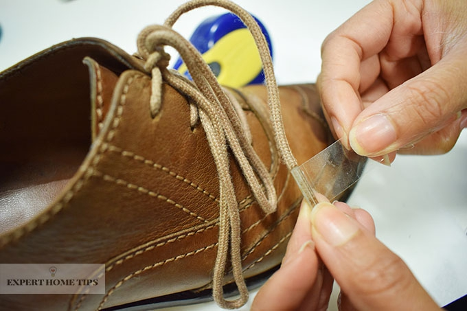 Shoelace repaired with Sellotape