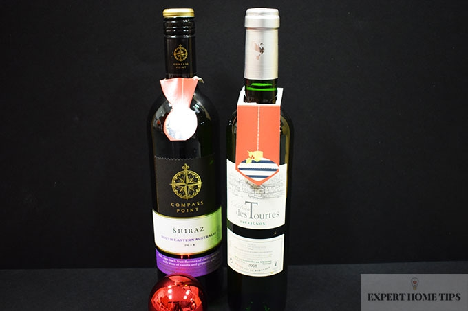 Decorate those wine bottles with old Christmas cards