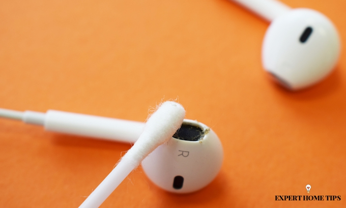 cleaning headphones with cotton bud