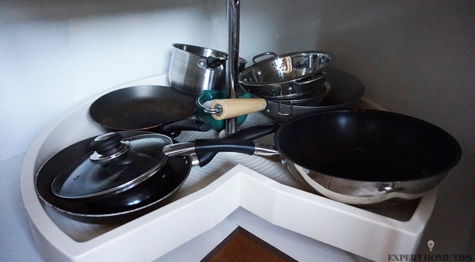 Pots and pans in cupboard
