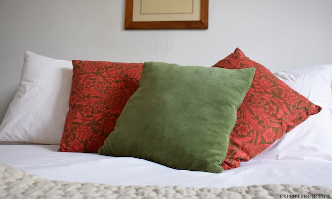 Bed with floral throw cushions