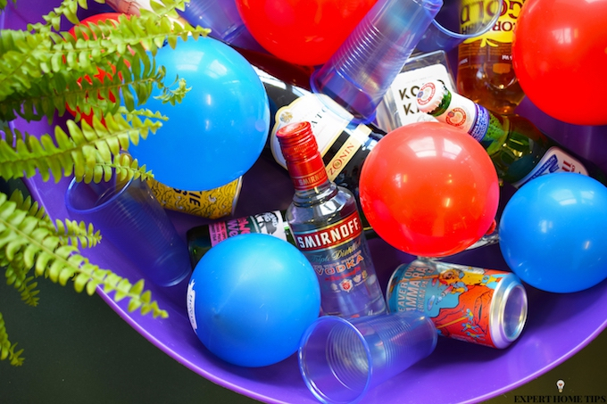 bucket of alcohol and balloon ice cubes