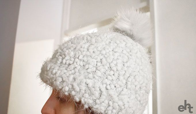 person wearing a bobble hat
