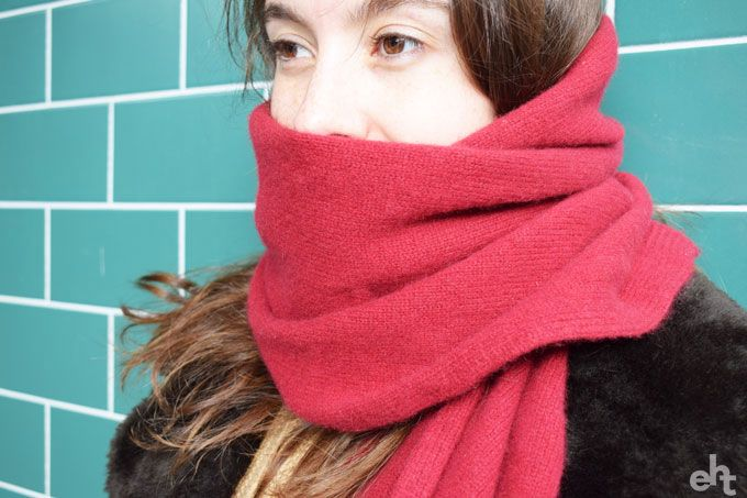woman wearing a red scarf