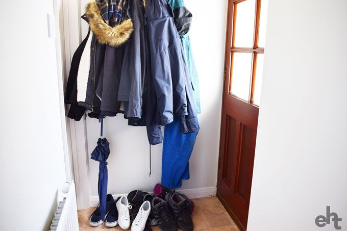 messy entryway with too many coats