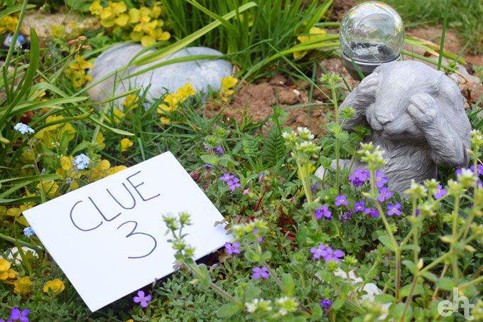 treasure hunt clue hidden in flower bed