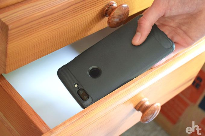 putting phone in drawer